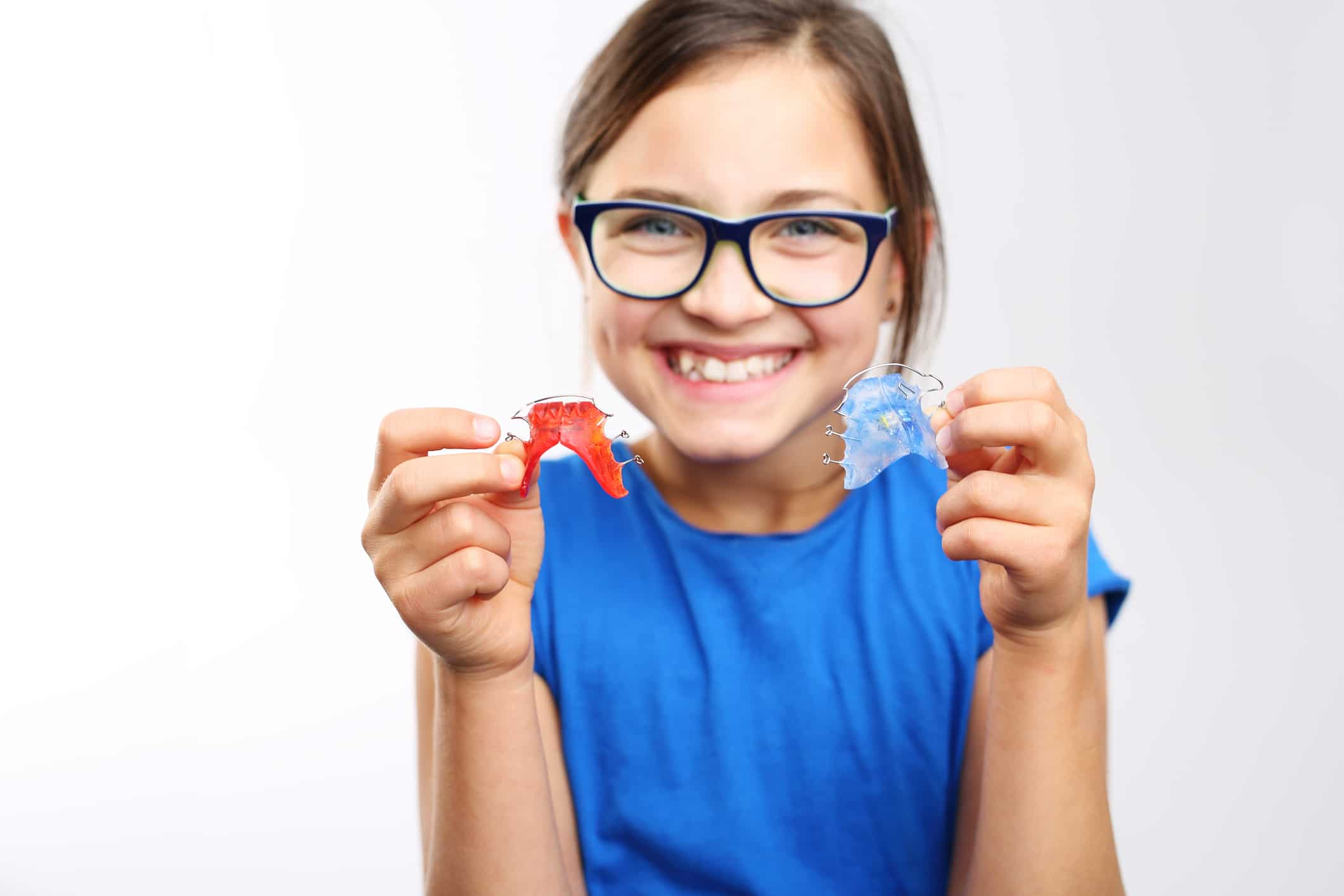 Child holding a retainer, Smile Envy Dental Group, Atlanta, GA